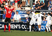 Players of the University of Akron pour the ice bucket on coach Porter at the end of the game, 2010llege Cup final against the University of Louisville at Harder Stadium, on December 12 2010, in Santa Barbara, California. Akron champions, 1-0.