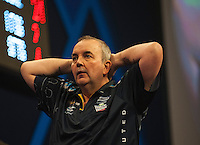 04.01.2015.  London, England.  William Hill PDC World Darts Championship.  Finals Night.  Phil Taylor (2) [ENG] shows his frustration during his game with Gary Anderson (4) [SCO]. Gary Anderson won the match 7-6