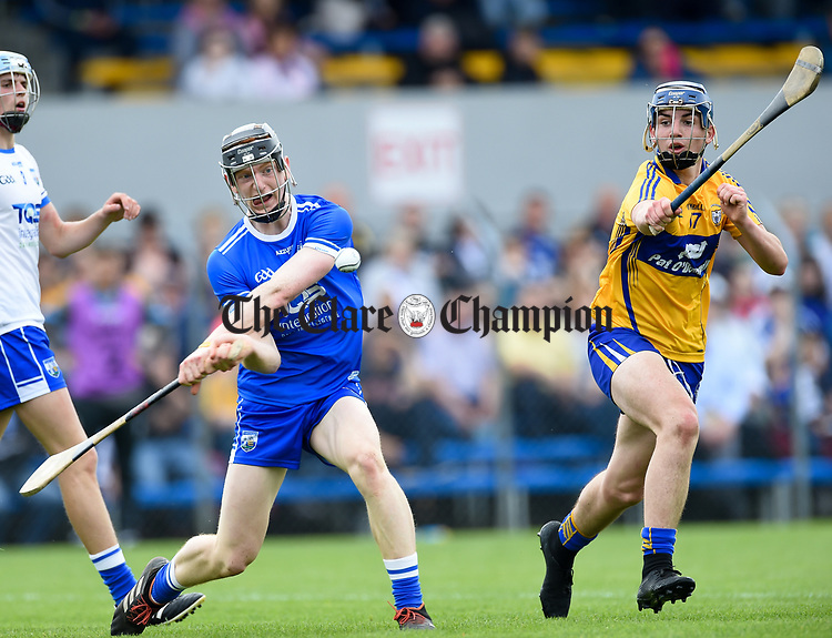Dean Beecher of Waterford  in action against Jack Minogue of Clare during their Munster  championship round robin game at Cusack Park Photograph by John Kelly.