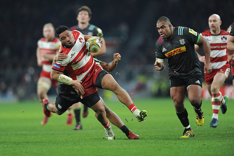 Motu Matu'u of Gloucester Rugby is tackled by Alofa Alofa of Harlequins during the Aviva Premiership Rugby match between Harlequins and Gloucester Rugby at Twickenham Stadium on Tuesday 27th December 2016 (Photo by Rob Munro/Stewart Communications)