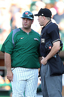 Fort Wayne TinCaps Shawn Wooten #35 talks with umpire Mike Patterson during a game against the Quad Cities River Bandits at Parview Field on July 25, 2011 in Fort Wayne, Indiana.  Quad Cities defeated Fort Wayne 11-10.  (Mike Janes/Four Seam Images)