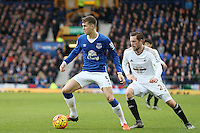 John Stones and Gylfi Sigurdsson during the Barclays Premier League match between Everton and Swansea City played at Goodison Park, Liverpool