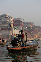 Indian Television or TV crew filming from rowing boat outside of Dashashwamedh Ghat, Varanasi, India.