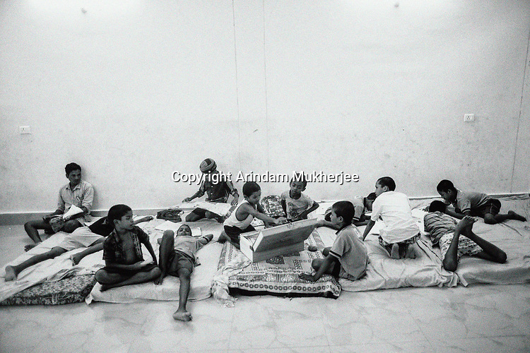 Students relax during their free time in the Sukma Football Academy boys' hostel. Sukma, Chattisgarh, India. Arindam Mukherjee