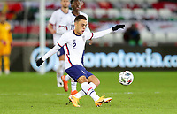 SWANSEA, WALES - NOVEMBER 12: Sergino Dest #2 of the United States takes clears a ball during a game between Wales and USMNT at Liberty Stadium on November 12, 2020 in Swansea, Wales.