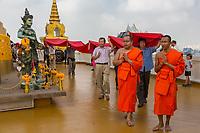 Bangkok, Thailand.  Wat Saket (Phu Khao Thong), the Golden Mount.  Monks Lead Donors around the Golden Chedi.