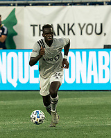 FOXBOROUGH, MA - SEPTEMBER 23: Karifa Yao #24 of Montreal Impact brings the ball forward during a game between Montreal Impact and New England Revolution at Gillette Stadium on September 23, 2020 in Foxborough, Massachusetts.