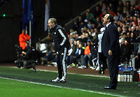 Swansea, UK. Thursday 20 February 2014<br /> Pictured L-R: Managers Garry Monk of Swansea and Rafa Benitez of Napoli<br /> Re: UEFA Europa League, Swansea City FC v SSC Napoli at the Liberty Stadium, south Wales, UK