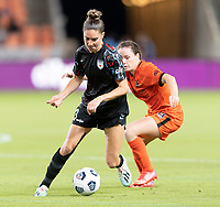 HOUSTON, TX - SEPTEMBER 10: Morgan Gautrat #13 of the Chicago Red Stars brings the ball up the field in front of Allysha Chapman #2 of the Houston Dash during a game between Chicago Red Stars and Houston Dash at BBVA Stadium on September 10, 2021 in Houston, Texas.