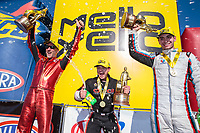Sep 23, 2018; Madison, IL, USA; NHRA top fuel driver Steve Torrence (center) celebrates with pro stock motorcycle rider Matt Smith (left) and pro stock driver Tanner Gray after winning the Midwest Nationals at Gateway Motorsports Park. Mandatory Credit: Mark J. Rebilas-USA TODAY Sports