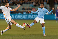 Melbourne, 21 July 2015 - Kostas Manolas of AS Roma and Raheem Sterling of Manchester City compete for the ball in game two of the International Champions Cup match at the Melbourne Cricket Ground, Australia. City def Roma 5-4 in Penalties. (Photo Sydney Low / AsteriskImages.com)