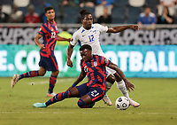 KANSAS CITY, KS - JULY 15: George Bello #21 of the United States chases down a loose ball during a game between Martinique and USMNT at Children's Mercy Park on July 15, 2021 in Kansas City, Kansas.