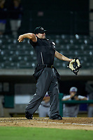 Home plate umpire Jake Bruner throws a new baseball to the pitcher during the Carolina League game between the Winston-Salem Dash and the Myrtle Beach Pelicans at TicketReturn.com Field on May 16, 2019 in Myrtle Beach, South Carolina. The Dash defeated the Pelicans 6-0. (Brian Westerholt/Four Seam Images)