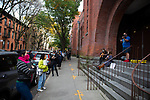 BROOKLYN, NY — OCTOBER 27, 2020:  Musicians play for people waiting in line to vote outside of the Park Slope Armory during early voting for the 2020 U.S. presidential election on October 27, 2020 in the Brooklyn borough of New York City.  Photograph by Michael Nagle