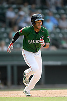 Third baseman Brandon Howlett (35) of the Greenville Drive runs toward first base in a game against the West Virginia Power on Sunday, May 19, 2019, at Fluor Field at the West End in Greenville, South Carolina. Greenville won, 8-4. (Tom Priddy/Four Seam Images)