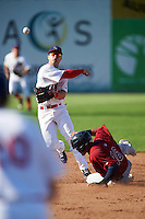 Auburn Doubledays second baseman Dalton Dulin (1) throws to first as Gian Paul Gonzalez (16) slides in during a game against the Mahoning Valley Scrappers on July 17, 2016 at Falcon Park in Auburn, New York.  Mahoning Valley defeated Auburn 3-2.  (Mike Janes/Four Seam Images)