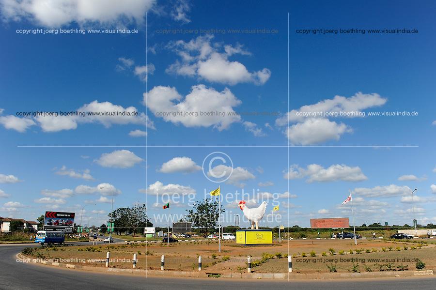 ZAMBIA Lusaka city center, advertisement of Hybrid chicken farm on roundabout