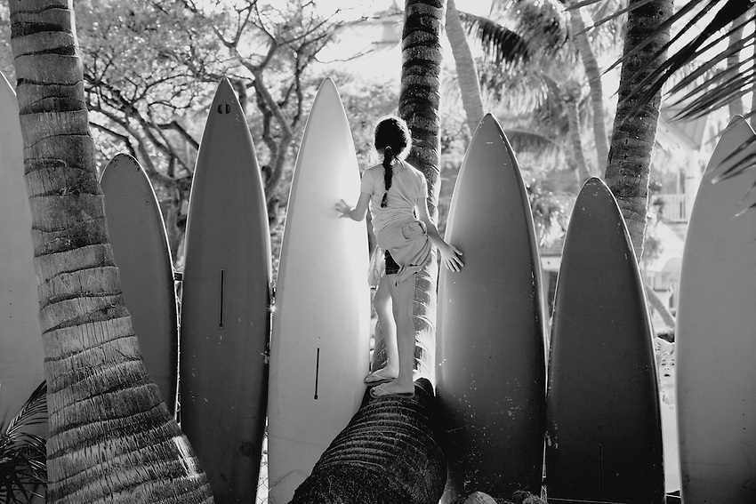 Girl with friends playing around surfboards at Key Largo, Florida<br />