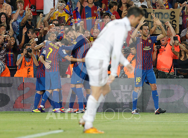 FC Barcelona's players celebrates goal in presence of Real Madrid's Cristiano Ronaldo (c) dejected during Spanish Supercup 2nd match.August 17,2011. (ALTERPHOTOS/Acero)