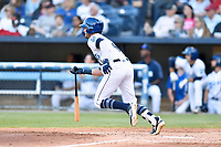 Asheville Tourists Cade Harris (4) runs to first base during a game against the Lakewood BlueClaws at McCormick Field on June 14, 2019 in Asheville, North Carolina. The BlueClaws defeated the Tourists 7-5. (Tony Farlow/Four Seam Images)