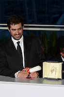 Iranian actor Shahab Hosseini poses with the award for Best Actor for the movie 'The Salesman' at the Palme D'Or Winner Photocall during the 69th annual Cannes Film Festival at the Palais des Festivals on May 22, 2016 in Cannes, France.
