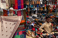 Sellers display shoes and rugs for sale at the street market on Meena Bazar in the Chadni Chowk area of Delhi, India, on Tue., Dec. 11, 2018.