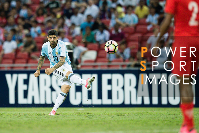 Ever Banega of Argentina (L) looks to bring the ball down during the International Test match between Argentina and Singapore at National Stadium on June 13, 2017 in Singapore. Photo by Marcio Rodrigo Machado / Power Sport Images