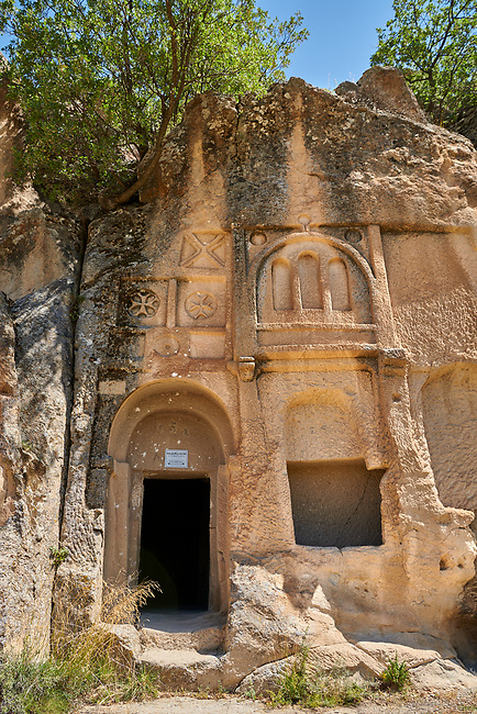 """Pictures & images of Kalburlu (St. Epthemios) church decorative sculptures, 9th century, the Vadisi Monastery Valley, """"Manastır Vadisi"""",  of the Ihlara Valley, Guzelyurt , Aksaray Province, Turkey.<br /> <br /> Kalburlu (St. Epthemios) church dates back to the 9th or 10th century. It is carved out of a single rock massive with rock columns holding up the roof of its church . The arches of Kalburlu (St. Epthemios) church have rich architectural decorated relif sculptures. The naves are connected by rounded arches & there is a baptismal font to the east of the main entrance."""