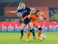BREDA, NETHERLANDS - NOVEMBER 27: Julie Ertz #8 of the USWNT fights for the ball with Jill Roord #19 of the Netherlands during a game between Netherlands and USWNT at Rat Verlegh Stadion on November 27, 2020 in Breda, Netherlands.