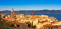 Aerial sunrise on Saint-Tropez ancient village, with the Mediterranean gulf of Saint-Tropez and the mountains in the background, Azure Coast France