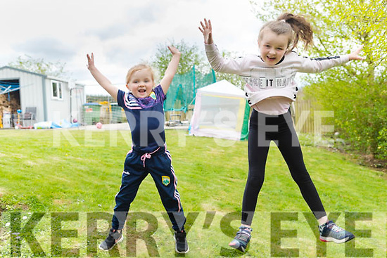 """Eloisha and Tiarna Falvay at home in Milltown, doing their TicTock jump for the """"Stars in the Livingroom"""" fundraiser for Milltown/Castlemaine GAA Club."""