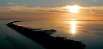 The sun sets on St.Vincent Island, top right, and Little St.George Island along the Forgotten Coast in Franklin County southwest of Tallahassee, Florida.  (Mark Wallheiser/TallahasseeStock.com)