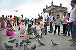 MUMBAI, INDIA - SEPTEMBER 27, 2010: The always busy scene of the Gateway to India outside the Taj Mahal Palace and Tower Hotel in Mumbai. The hotel has re-opened after the terror attacks of 2008 destroyed much of the heritage wing. The wing has been renovated and the hotel is once again the shining jewel of Mumbai. pic Graham Crouch