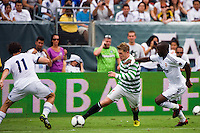 Kris Commons (15) of Celtic F. C. is marked by Esteban Granero (11) and Lass Diarra (24) of Real Madrid. Real Madrid defeated Celtic F. C. 2-0 during a 2012 Herbalife World Football Challenge match at Lincoln Financial Field in Philadelphia, PA, on August 11, 2012.