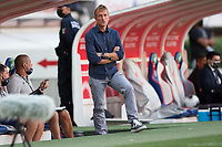 ZAPOPAN, MEXICO - MARCH 21: Jason Kreis head coach of the United States on the top step of the dugout during a game between Dominican Republic and USMNT U-23 at Estadio Akron on March 21, 2021 in Zapopan, Mexico.