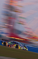 "2/5/05 Daytona Beach, FL.P.L. Newman speeds past the ferris wheel in the #79 ""Cars"" Ford/Crawford."