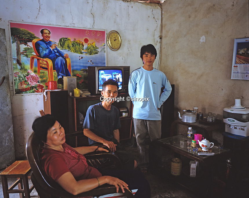 The Ye family, (left to right) Wan Ying, Ye Xiang Ning, 51 & Ye Xiao Chen, 19 in Danzhou County, Hainan Island, China. The Ye's have three sons, two have left for Guangzhou since they were unable to find brides. Danzhou city has the highest gender imbalance in China with 170 males born for every 100 females according to figures from Chinese Government 5t National Census. The imbalance is already having a massive social impact on society and is expected to get worse while the ruthless One Child Policy, aimed at curbing China's 1.3 billion population, continues to be law. The area is begining to rigidly enforce the policy due to the massive problem of gender selection..PHOTO BY SINOPIX
