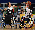 Katie Harnock (10) of Kitchener, Ont. blocks Mika Takabayashi of Japan in women's wheelchair basketball action at the Paralympic Games in Beijing,Tuesday, Sept., 9, 2008.   Photo by Mike Ridewood/CPC