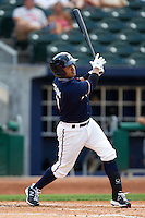 Christian Colon (4) of the Northwest Arkansas Naturals at bat during a game against the San Antonio Missions at Arvest Ballpark on June 30, 2011 in Springdale, Arkansas. (David Welker / Four Seam Images)