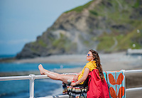 WEATHER PICTURE WALES One female RNLI Lifeguard makes the most of the sunshine whilst keeping a watch over the people on the beach. People enjoy the sunshine in Aberystwyth, Wales, UK. Thursday 23 June 2016