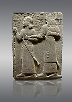 "Picture & image of Hittite monumental relief sculpted orthostat stone panel of Royal Buttress. Basalt, Karkamıs, (Kargamıs), Carchemish (Karkemish), 900-700 B.C. Anatolian Civilisations Museum, Ankara, Turkey.<br /> <br /> King Araras holds his son Kamanis from the wrist. King carries a sceptre in his hand and a sword at his waist while the prince leans on a stick and carries a sword on his shoulder. <br /> <br /> Hieroglyphs reads; ""This is Kamanis and his siblings. I held his hand and despite the fact that he is a child, I located him on the temple. This is Yariris' image"".  <br /> <br /> Against a gray background."