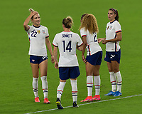 ORLANDO CITY, FL - FEBRUARY 18: Substitutes Kristie Mewis #22, Emily Sonnett #14, Casey Krueger #2 and Alex Morgan #13 gather to complete their fitness during a game between Canada and USWNT at Exploria stadium on February 18, 2021 in Orlando City, Florida.
