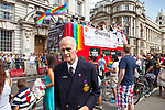 """© Joel Goodman - 07973 332324 - all rights reserved . 03/07/2010 . London , UK . A man wearing a badge in support of Clause 28 ( Section 28 ) and another that says """" Jesus Saves """" turns his back on a """" Diversity Bus """" on Whitehall . Annual London Pride march and demonstration through the centre of London . Photo credit : Joel Goodman"""