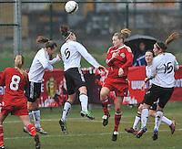 Denmark U17 - Germany U17 : kopduel met 4 Maja Kildemoes (rood) die scoort en 5 Johanna Tietge.foto Joke Vuylsteke / Vrouwenteam.be