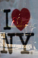 NEW YORK, NY - NOVEMBER 16: People are reflected on a window as they walk around Times Square on November 16, 2020 in New York. Some souvenir shops are closing and others struggling to survive the covid-19 pandemic, as no tourist visit NYC due to the virus surging again and many travel restrictions still in place, where international arrivals in main airports were down by 93 percent, according to Port Authority data. (Photo by Eduardo MunozAlvarez/VIEWpress)