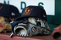A Bowling Green Hot Rods cap sits on top of a glove in the visitors dugout during the game against the Fort Wayne TinCaps at Parkview Field on August 20, 2019 in Fort Wayne, Indiana. The Hot Rods defeated the TinCaps 6-5. (Brian Westerholt/Four Seam Images)