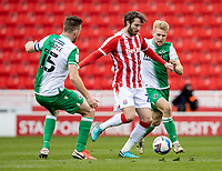 5th April 2021; Bet365 Stadium, Stoke, Staffordshire, England; English Football League Championship Football, Stoke City versus Millwall; Nick Powell of Stoke City under pressure from Billy Mitchell and Alex Pearce of Millwall