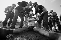 111th Paris-Roubaix 2013..Fabian Cancellara (CHE) exhausted (& happy) after winning his 3rd Paris-Roubaix. Helped back up by press officer Tim Vanderjeugd & DS Dirk Demol.