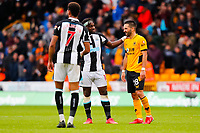 2nd October 2021;  Molineux Stadium, Wolverhampton,  West Midlands, England; EFL Cup football, Wolverhampton Wanderers versus Newcastle United; Ruben Neves of Wolverhampton Wanderers and Allan Saint-Maximin of Newcastle United share a joke after the final whistle