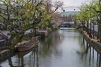 Japan, Okayama Prefecture, Kurashiki. Boats on the river.